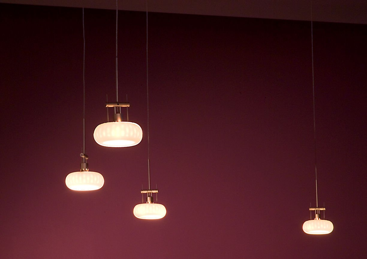 Five Street Lounge round pendant bar lights by InUnison Design